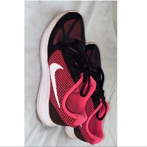 Pink and black nike running shoes